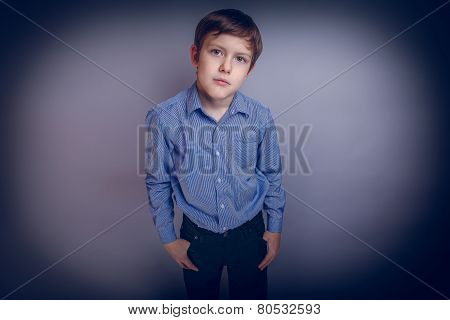 Portrait of a boy adolescence European appearance Brown cross pr