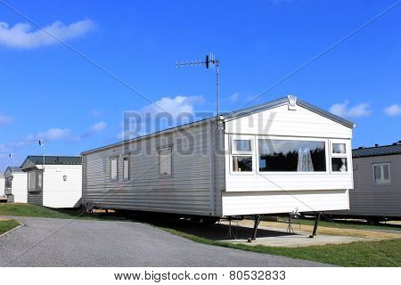 Exterior of a modern caravan on a trailer park in summer, England.