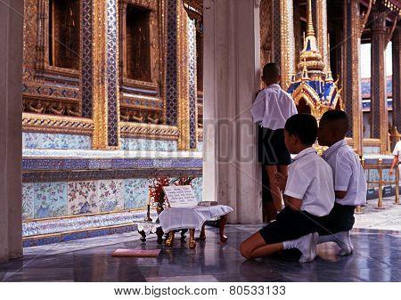 Boys praying, Bangkok.