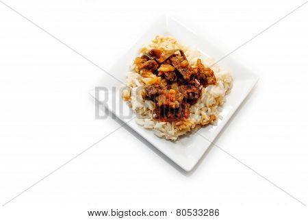 Beef & Veggie Stir Fry Served On A White Square Plate
