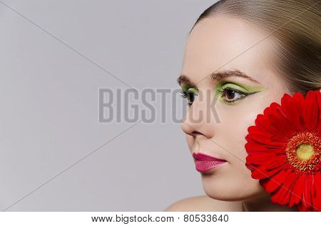 woman wearing a flower in her hair horizontal
