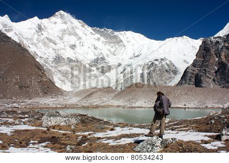 Man Watching Cho Oyu - Cho Oyu Base Camp - Nepal