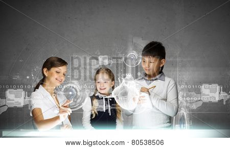 Young teacher and her pupils examining hologram of human heart