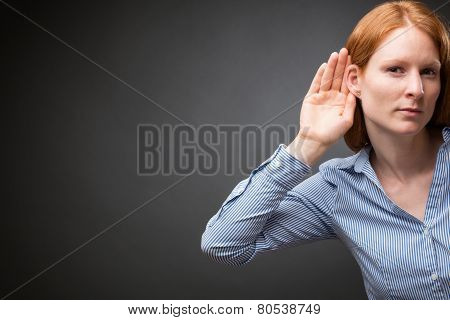Businesswoman Listens To Something