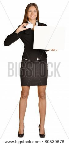 Business woman holding in one hand a white cardboard paper and the other blank business card.