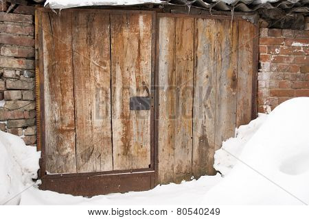 Old Disused Derelict Wooden Door and Snow