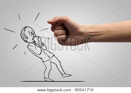Close up of human fist fighting with businessman caricature