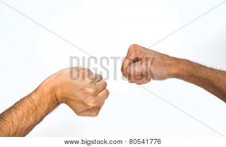 Two orientations of a man clenching his fist, one sideways and one viewed from overhead with a bent wrist, close up view of the arm isolated on white