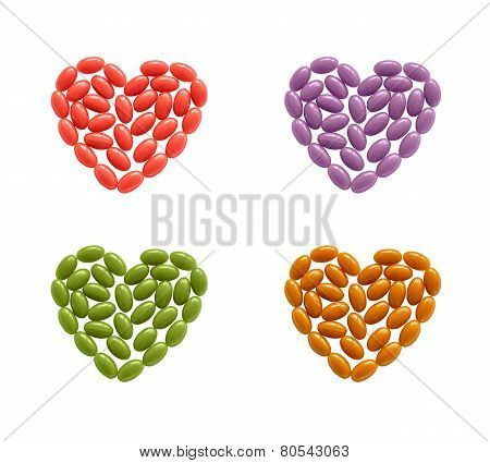 Hearts of coloful pills isolated
