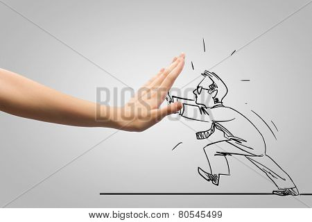 Caricature of businessman and human hand showing stop gesture
