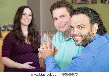 Happy Gay Parents With Pregnant Woman