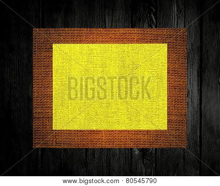 yellow linen rustic canvas textured on dark wood background
