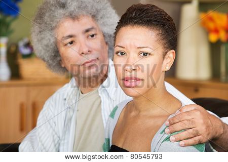 Concerned Woman With Spouse