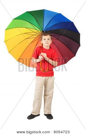 Little Boy In Red Shirt With Big Multicolored Umbrella Standing On White