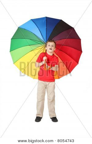 Little Boy In Red Shirt Opened Mouth With Big Multicolored Umbrella Standing On White