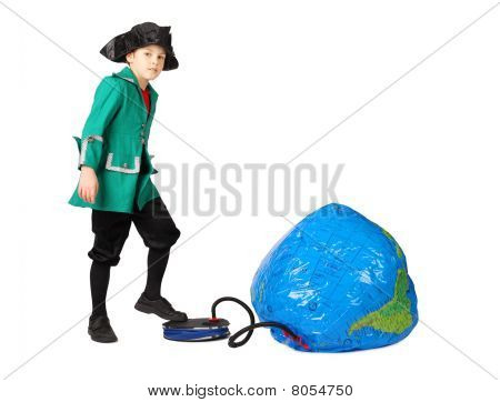 Little Boy In Historical Dress Pumping Inflatable Globe Isolated