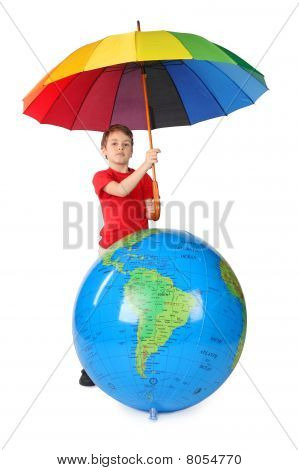 Boy In Red Shirt With Multicolored Umbrella And Inflatable Globe Isolated On White