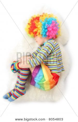 Boy In Clown Dress Sleeping View Frome Above Isolated On White Background