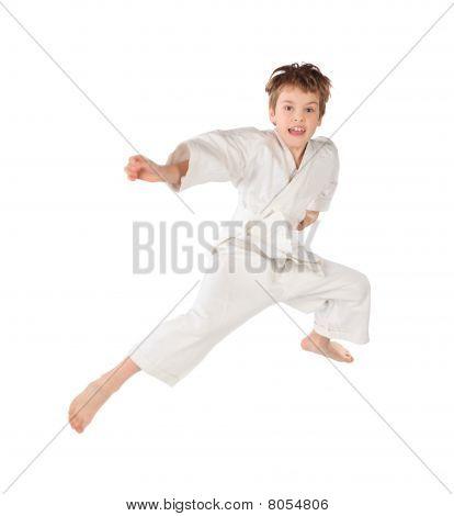 Karateka Boy In White Kimono Jumping Isolated On White Background