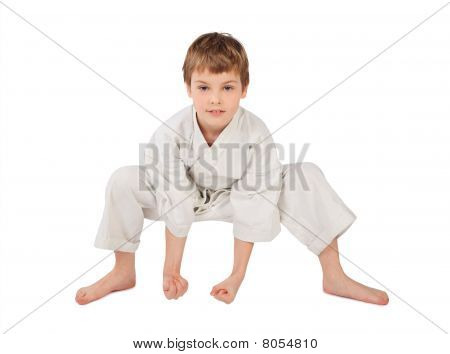 Karateka Boy In White Kimono Isolated On White Background