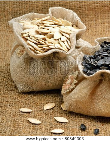 Pumpkin Seeds And Sunflower Seeds In The Bags On Sacking Background