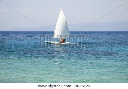 sailing boat on turquoise sea