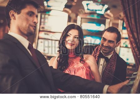 People near slot machine in a casino