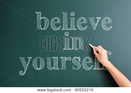 writing believe in yourself on blackboard