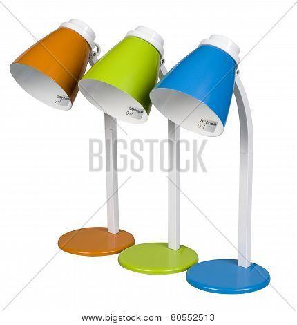 Three Modern Desk Lamps In Different Colors Isolated On White, With Clipping Path
