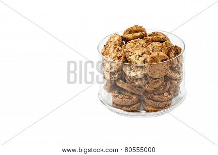 Cookies With Nuts And Raisins In A Glass Container