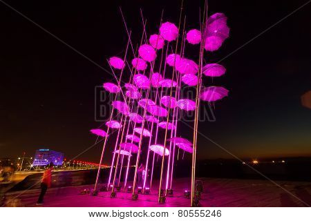 Umbrellas Of Thessaloniki, Greece. The Sculpture Was Illuminated With The Color That Symbolizes Brea