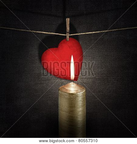 Burning Candle And Red Paper Heart On A Rope