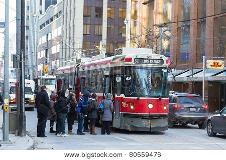 People Boarding A Streetcar In Toronto