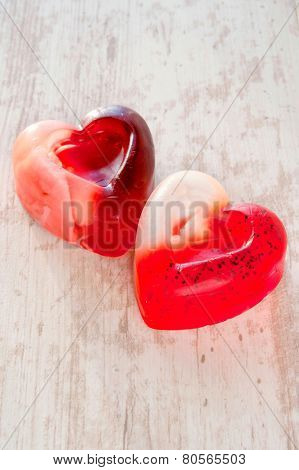 Two Homemade Heart Shaped Translucent Soap. Closeup.