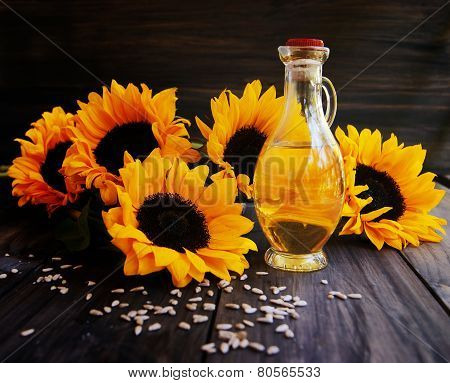 Sunflowers, sunflower seeds and a bottle of oil