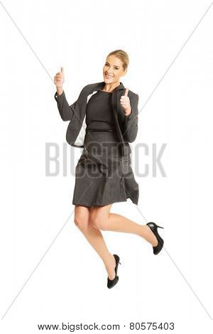 Picture of a cheerful jumping businesswoman