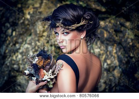 Young Beautiful Girl With A Wreath In The Sea Theme, Holding A Bouquet Of Sea Urchins.