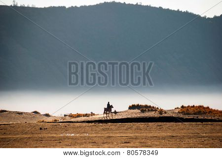 Horse Rider At Volcanic Plateau Of Miunt Bromo, Indonesia