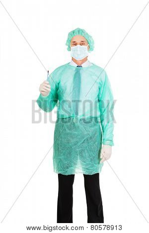 Male doctor with a scalpel wearing protective clothes.