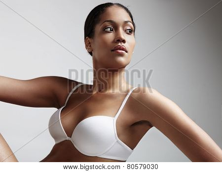 Woman Looking Aside And Wearing White Bra