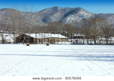 barn in mountains with snow