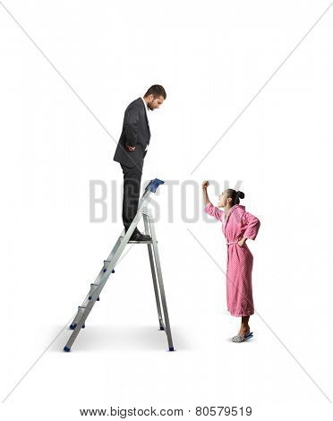dissatisfied man standing on the stepladder and looking down at angry screaming woman. isolated on white background