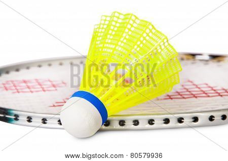 One Shuttlecock Lying Near The Badminton Racket