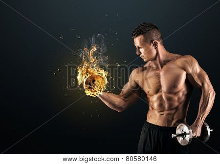 Muscular Man With Dumbbells On Dark Background