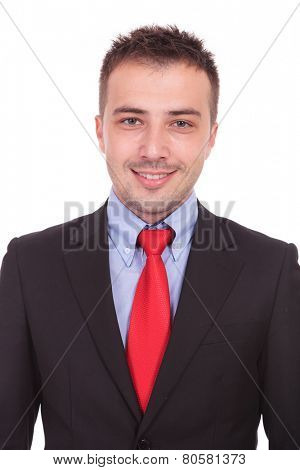 Close up picture of a handsome young business man smiling at the camera.