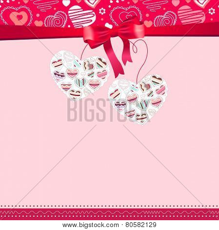 Greeting card with two hanging hearts