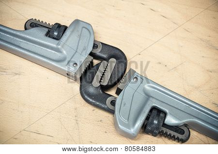 Tools set in vintage picture style . set of hand tools on a wooden background, Wrench tools or Pipe