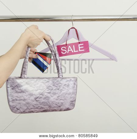 Woman Hand Shopping With Credit Cards On Sale