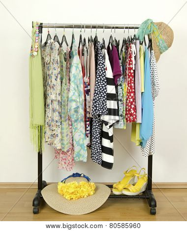 Wardrobe With Summer Clothes Nicely Arranged.