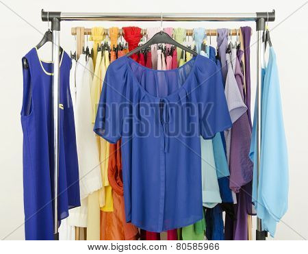 Cute Blue Outfits Displayed On A Rack.